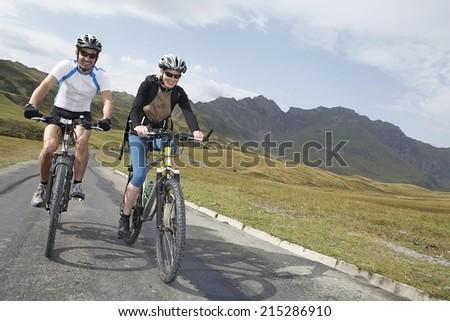 Riding in the mountains. Active life style and sport concept - stock photo