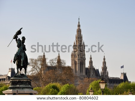 riding statue of arch duke charles in front of vienna's gothic town hall - stock photo