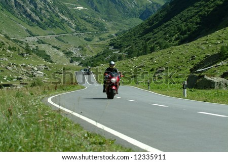 Riding the Nufenen pass, Switzerland - stock photo