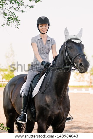 riding young woman portrait on horse in outdoor