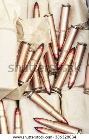 rifle bullet  in ammunition box on white background:Choose a focal point ammunition lying. - stock photo