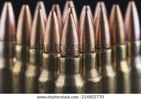 Rifle bullets close-up on black background