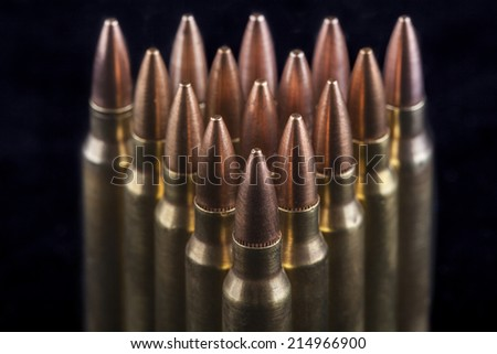 Rifle bullets close-up on black background - stock photo