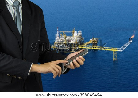 rig background with businessman hold smart phone