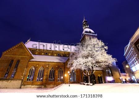 Riga cathedral at Dome square in Old Riga, Latvia at winter night - stock photo