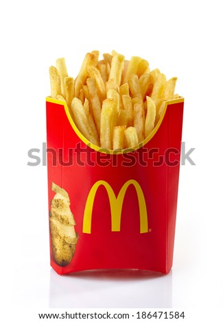 Riga,Latvia-April 09, 2014. McDonald's French fries on a white background. McDonald's Corporation is the world's largest fast food restaurant.