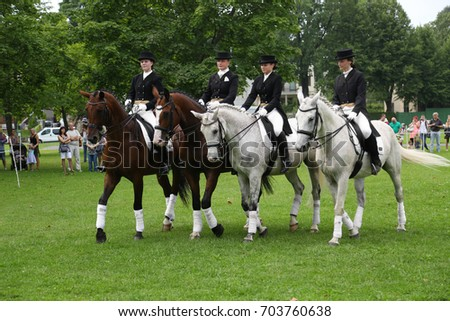 RIGA, LATVIA - AUGUST 19, 2017: Equestrian club members show performance of dressage on horseback within city day on August 19, 2017 in Riga, Latvia. The city day celebration is held annually.