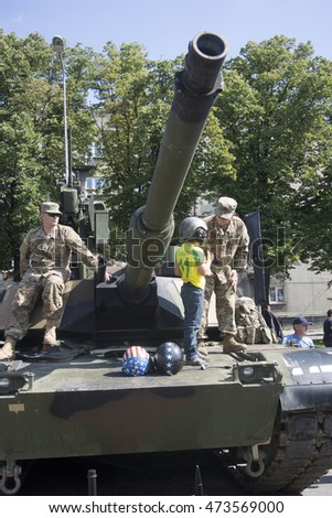 "Riga, Latvia Augustus 20, 2016. Demonstration of the American Abrams tanks on the street of Riga in day of the 25th anniversary of the voluntary militarized organizations ""Zemessardze"""