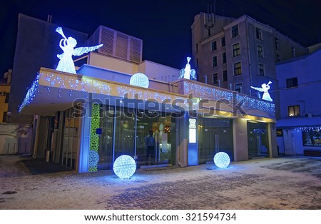 RIGA, LATVIA - DECEMBER 27, 2014: Building decorated with illuminated angel figures and shiny balls. Christmas time. Old Town of Riga, Latvia - stock photo