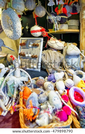 Riga, Latvia - December 25, 2015: Colorful smaller and bigger toys made from different materials at the stall during the Christmas Market in Riga, Latvia. There are handmade wool and linen accessories