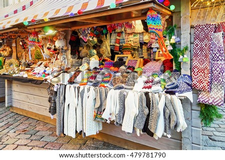 Riga, Latvia - December 25, 2015: Stall with colorful woolen clothes during the Christmas Market in Riga, Latvia. The market usually lasts from the beginning of December and till the start of January.