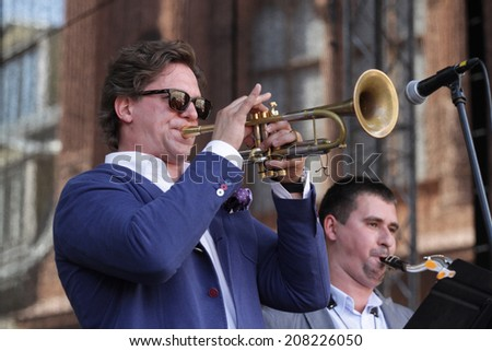 """RIGA, LATVIA - JUL 30: Famous jazzman from Russia Vadim Eilenkrig plays trumpet at free public concert within """"World Jazz Festival"""" on Jul 30, 2014 in Riga, Latvia. Festival is held for the first time - stock photo"""