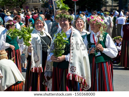 RIGA, LATVIA - JULY 07:  People in national costumes at the Latvian National Song and Dance Festival on July 07, 2013. Holiday was hold from 30th June 2013 till the 7th July 2013.
