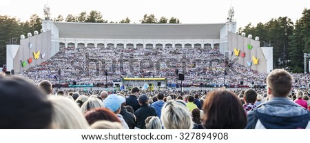 RIGA, LATVIA - July 12, 2015: The Latvian National Song and Dance Festival Grand Finale concert. View on mass choir from spectator seats. - stock photo