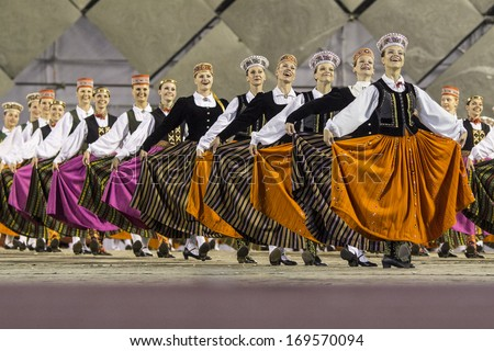 RIGA, LATVIA - July 4, 2013: The Latvian National Song and Dance Festival. Latvian dance grand performance at Our Fathers Piers - stock photo