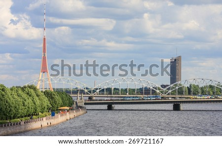RIGA, LATVIA - JUNE 17, 2008: Railway Bridge and TV tower in Riga, Latvia, by the river Daugava.