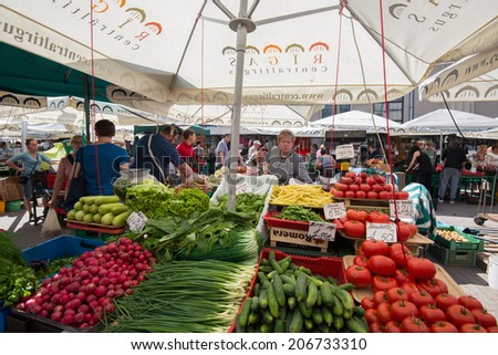 RIGA, LATVIA - JUNE 7: The open air area of Riga Central Market on June 7, 2014 in Riga, Latvia. The main structures of this market are five pavilions constructed by reusing old Zeppelin hangars. - stock photo