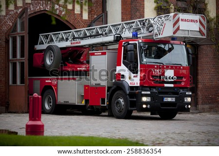 RIGA, LATVIA - MARCH 6, 2015: Iveco based firetruck at the depot - stock photo