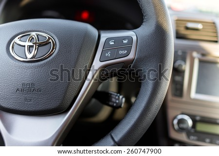 RIGA, LATVIA - MARCH 8, 2015: Steering wheel  and front console closeup of Toyota Avensis - stock photo