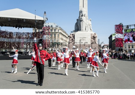 Riga, Latvia - May 4, 2016: Day of restoration of independence of Latvia. Performance of children's brass bands of Latvia (fashion show) at Freedom monument.