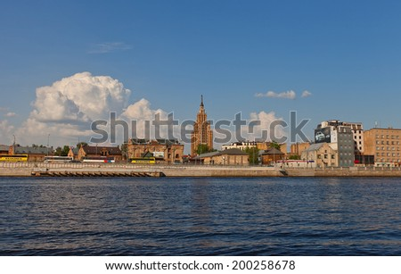 Riga, Latvia - May 25, 2014: Historical district Spikeri and skyscraper of Latvian Academy of Sciences in Riga, Latvia. View from Daugava river