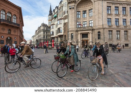 Riga, Latvia May 3, 2014: Riga Tweed Run participants in the Dome Square in the Old Town.