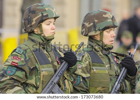 RIGA, LATVIA - NOV 18, 2013: Latvian soldiers at the Military parade of the National Armed Forces at the embankment of the 18th November anniversary of establishment of the Republic of Latvia
