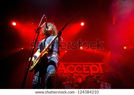 RIGA, LATVIA - NOV 11: Peter Baltes from German heavy metal band ACCEPT during show at Palladium on November 11, 2012 in Riga, Latvia. - stock photo