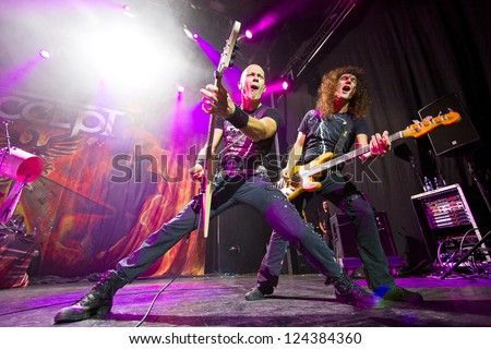 RIGA, LATVIA - NOV 11: Wolf Hoffmann and Peter Baltes from German heavy metal band ACCEPT performing at Palladium on November 11, 2012 in Riga, Latvia. - stock photo