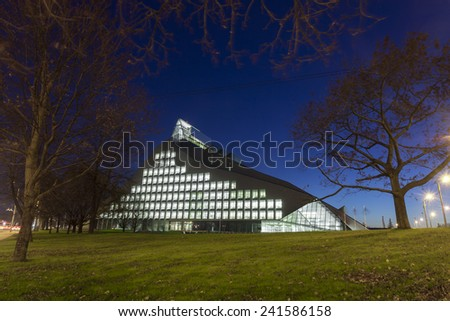 RIGA, LATVIA - OCTOBER 29, 2014: New Building of National Library of Latvia, known also as Castle of Light will be the main venue in Riga for Latvian Presidency of the Council of the European Union - stock photo