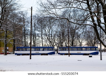 RIGA, LATVIA - 3RD JAN 2017: Trams in Riga during the day in the winter. Lots of snow can be seen.