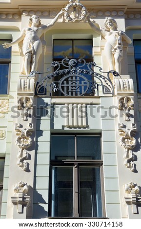 RIGA LATVIA SEPTEMBER 14 2015: Details of Art Nouveau buildings Over one third of all buildings in Riga are examples of this school of this unique architecture design style. - stock photo