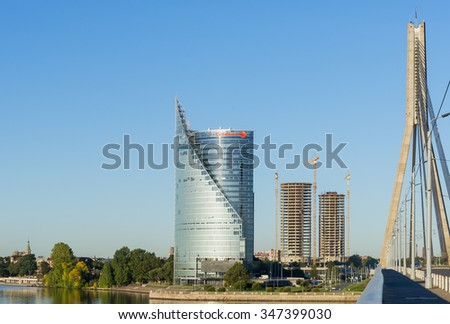 RIGA, LATVIA - SEPTEMBER 07, 2013: Modernt building of Swedbank and other buildings under construction on the left bank of Daugava river in Riga, Latvia