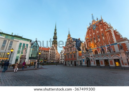 Riga, Latvia - September 10, 2015: View of the City Hall Square with House of the Blackheads and Saint Peter church.