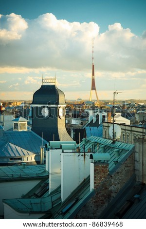 Riga rooftops, clock tower - stock photo