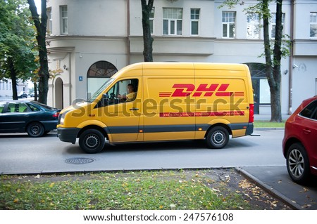 RIGA - SEP 8: DHL delivery van VW Crafter on Sep. 8, 2014 in Riga, Latvia. DHL is the world's largest logistics company operating around the world. DHL is a world market leader in sea and air mail. - stock photo