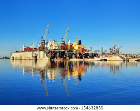 Riga shipyard with two cargo ships in the morning - stock photo