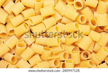Rigatoni italian pasta background, close up - stock photo