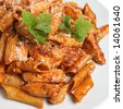 Rigatoni pasta with chicken - stock photo