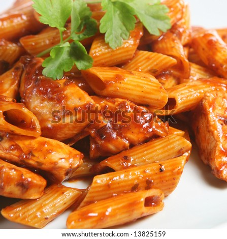Rigatoni pasta with chicken in a rich tomato and olive sauce - stock photo
