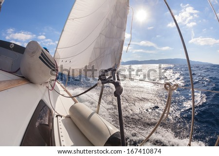 Rigging, ropes, shrouds and sail crop on the yacht  - stock photo