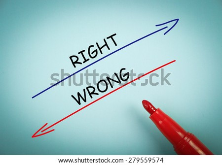 Right and wrong concept is on blue paper with a red marker aside. - stock photo