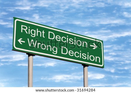 Right and Wrong Decision Road Sign Against Sky - stock photo