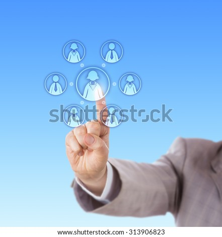 Right arm in light gray business suit is contacting a work team that has a female team leader. Index finger of a manager is touching the virtual white collar worker at the center of the work group.