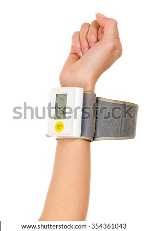 Right arm vertically wearing glucose meter around wrist with white background.