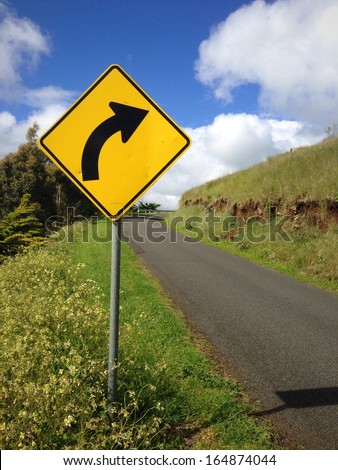 Right bend Road Sign - stock photo
