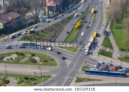 Right Hand Drive Roundabout taken from a balloon, heavy traffic in the Cracow city in Poland - stock photo