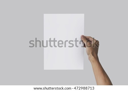 Right hand holding A4 paper in the right hand. Leaflet presentation. Pamphlet hand man. Man show offset paper. Sheet template. Book in hands. Booklet folding design. Fold paper sheet display read.