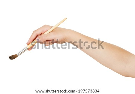 Right hand holding aquarelle brush, isolated on white, clipping path - stock photo