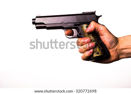right hand holding the gun - stock photo